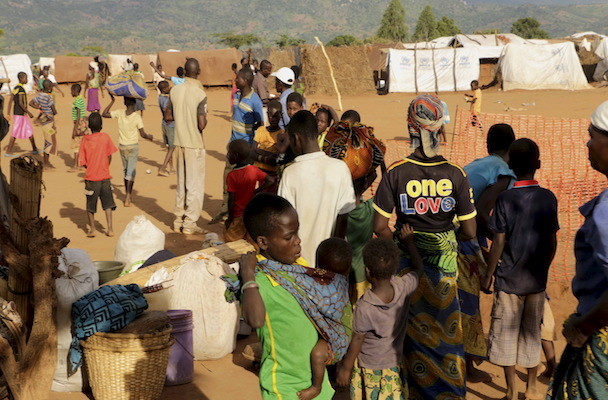 Mozambican refugees wait for registration at Kapise camp in Malawi's Mwanza district,